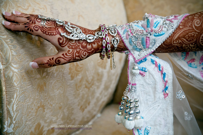 detail of Asian wedding jewelley on bride's hand