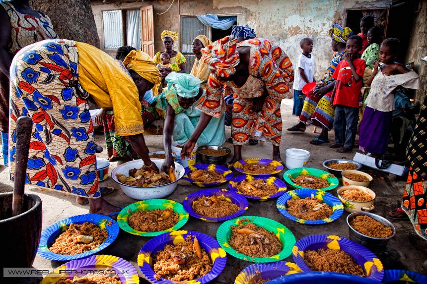 Gambian women in Serrekunda serving celebratory food