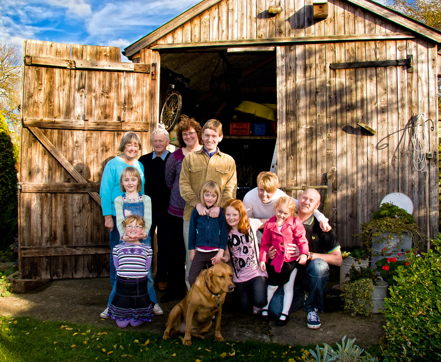 Lifestyle family birthday portrait on back cover of photo album