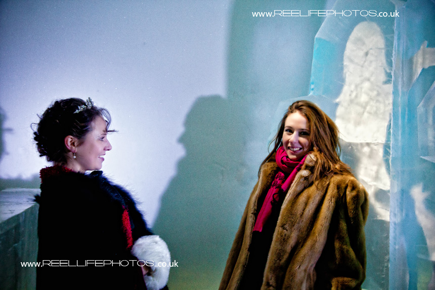Ice Hotel bride with her best friend in the Absolut Ice Bar