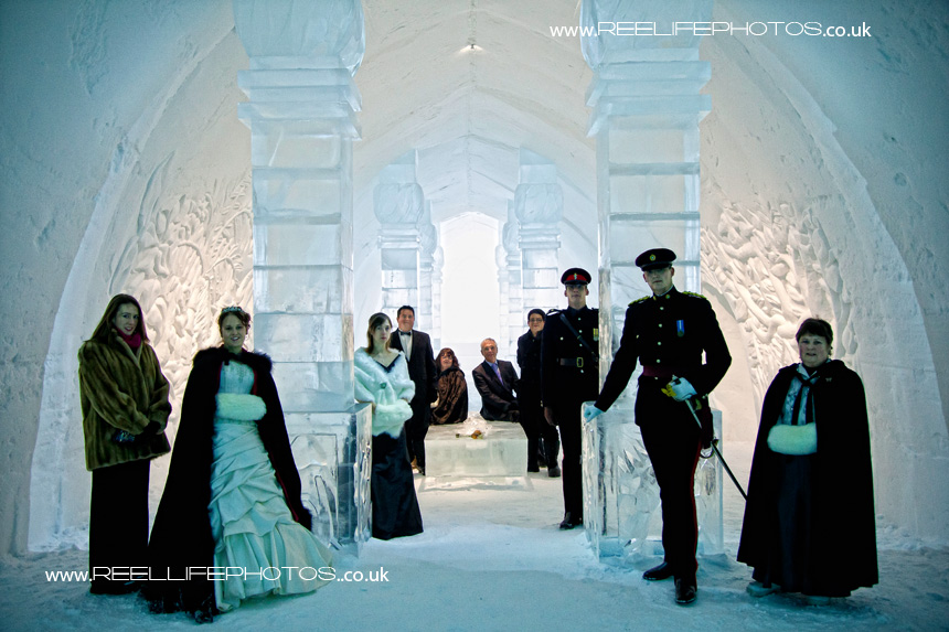bridal party posing innside Ice Hotel main chamber