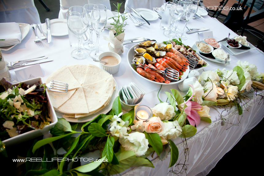 wedding starter of oysters and king prawns, dips and pitta bread
