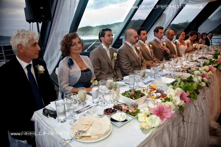 Top table with groom's Greek parents on left in foregeound