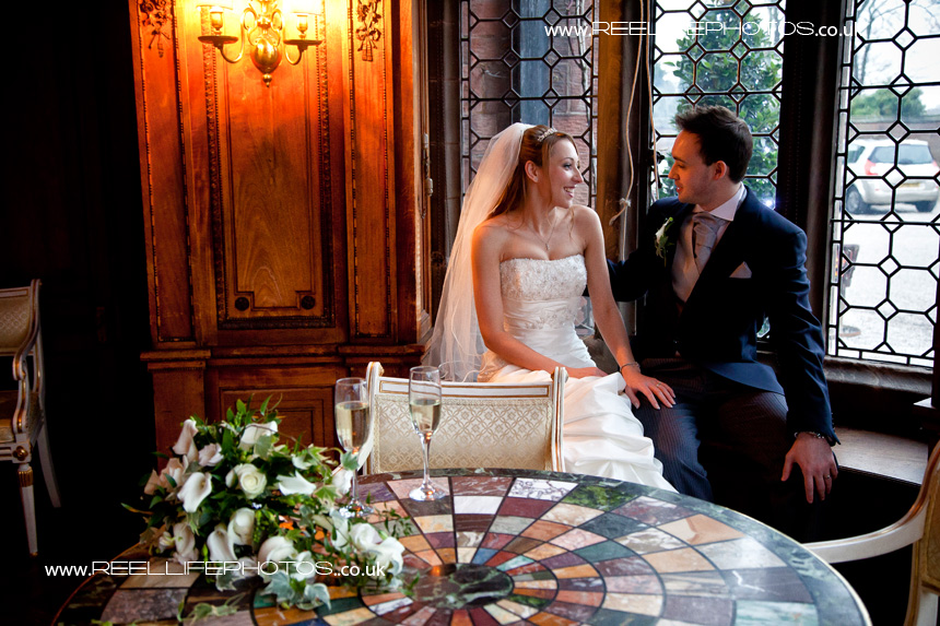 wedding picture in natural light by window at Thornton Manor
