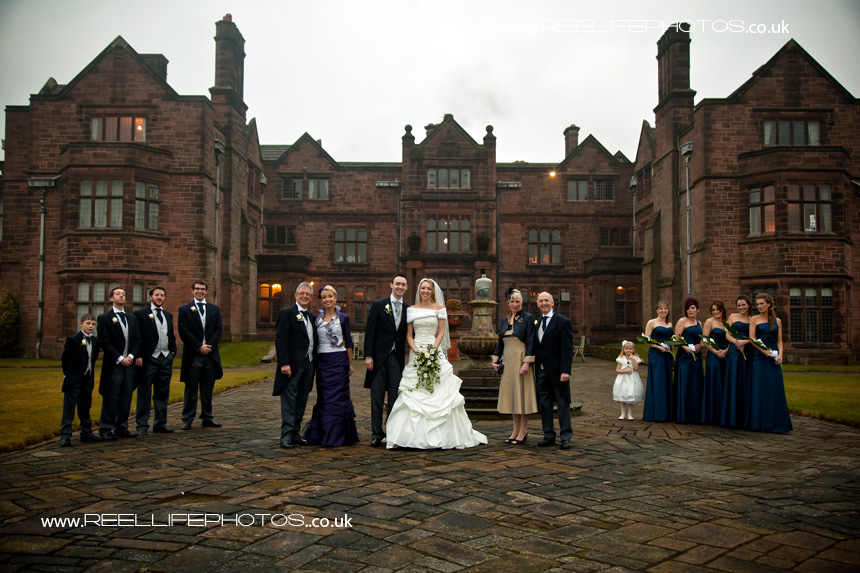 Winter wedding with bridal party outside Thornton Manor