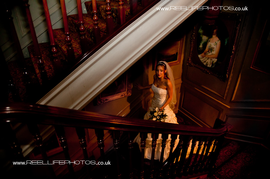bride going downstairs to her wedding