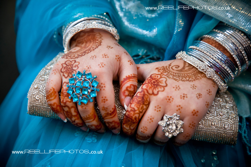 Mehndi (henna) on hands with beautiful rings