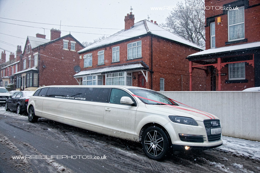 wedding limo in the snow outside bride's house in Leeds
