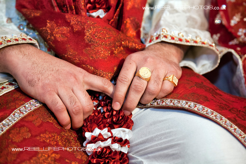 detail of the groom's hands