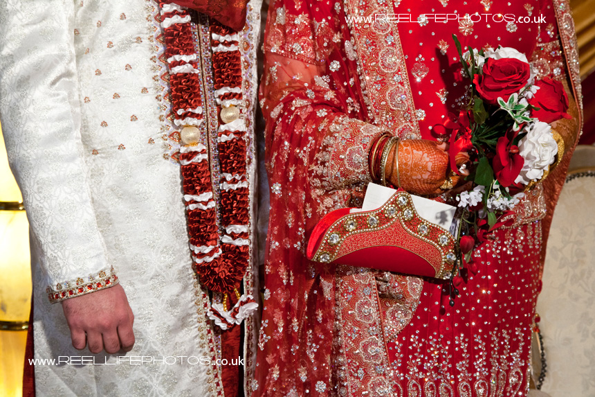 Detail of Asian bride and groom while standing up