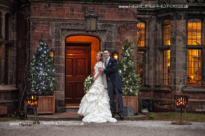 winter wedding picture of bride and groom outside Thornton Manor