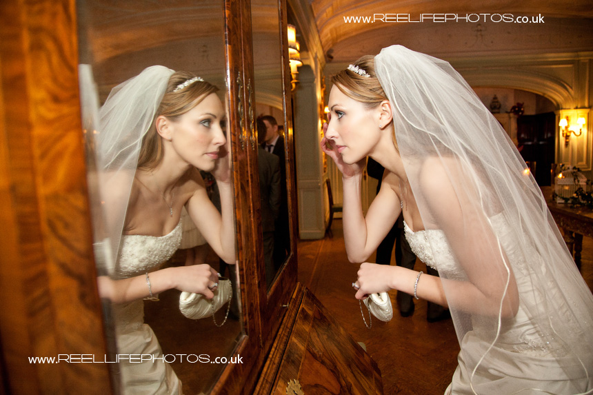Bride and her mirror reflection
