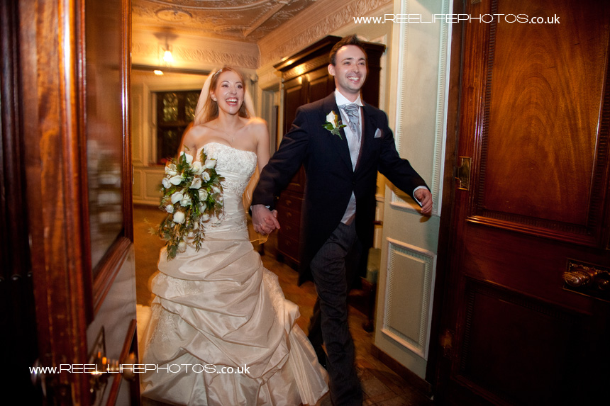 Grand entrance - bride and groom  walking in to their wedding reception at Thornton Manor