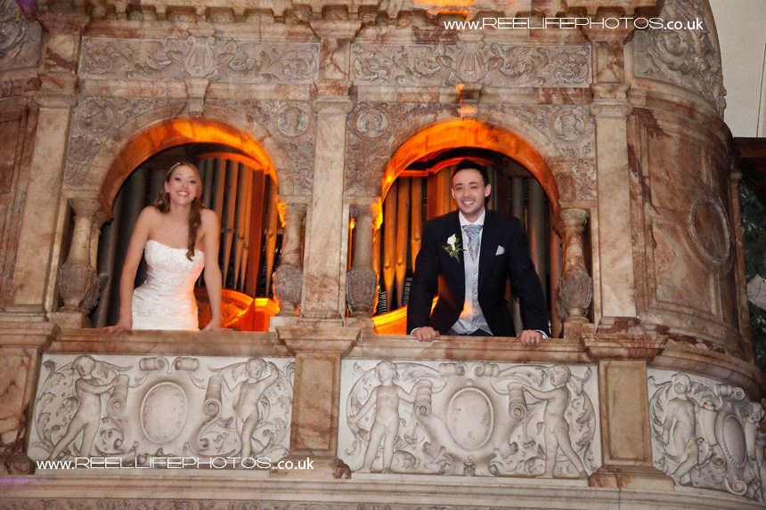 bride and groom as Romeo and Juliet on the balcony at Thornton Manor