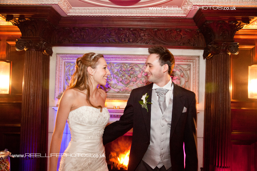 bride and groom by the fireplace at Thornton Manor