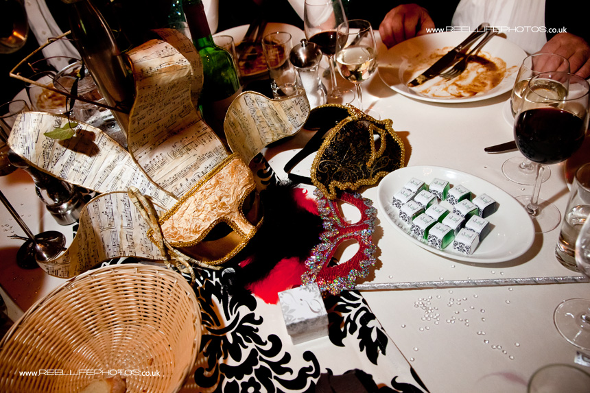 Masks on the table during evening wedding reception