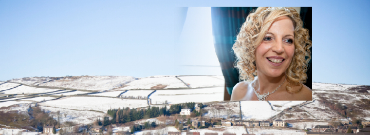 bride against view of snowy fields from her window