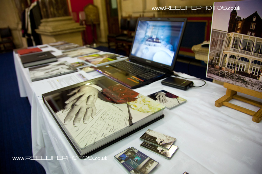 wedding storybook albums and Ice Hotel picture on laptop screen