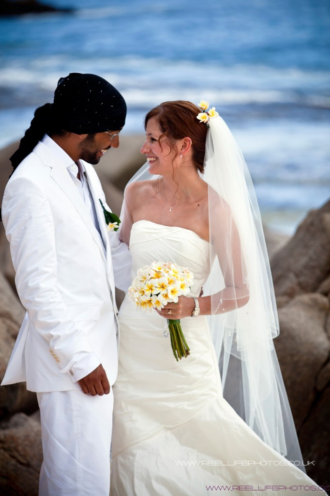 Seychelles bride and groom by sea