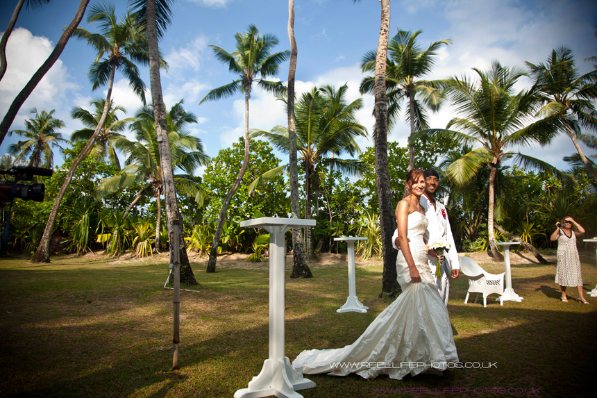 dream wedding couple walk into their Seychelles wedding reception venue at Cap Lazare