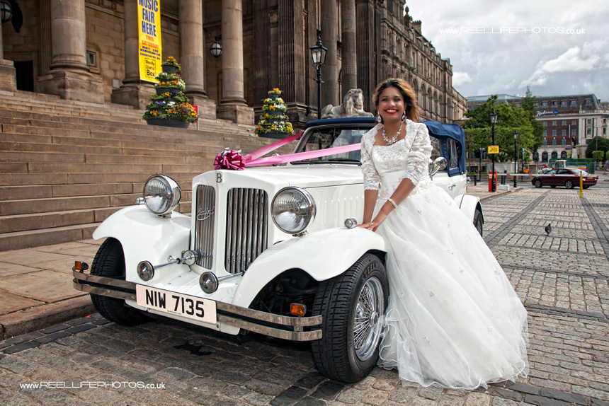 wedding photography Leeds: bride with wedding car