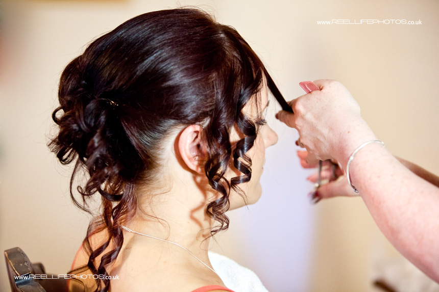 adult bridesmaid having her hair done professionally