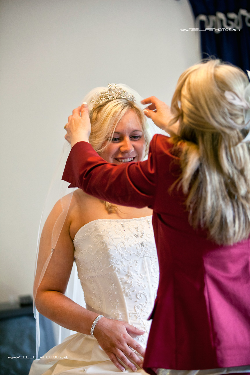bride's Mum helping her on with her Tiara