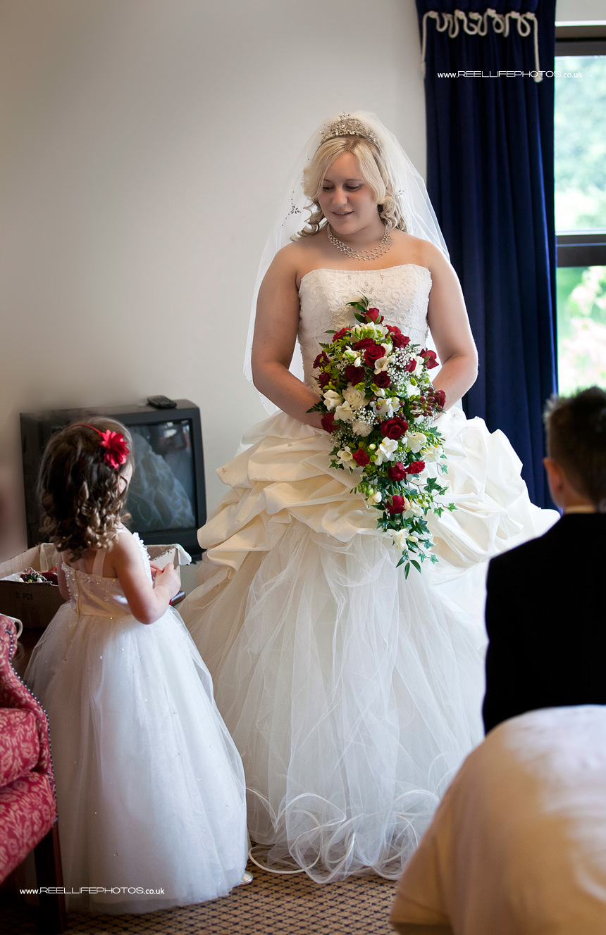 bride and her daughter share a private moment before the wedding