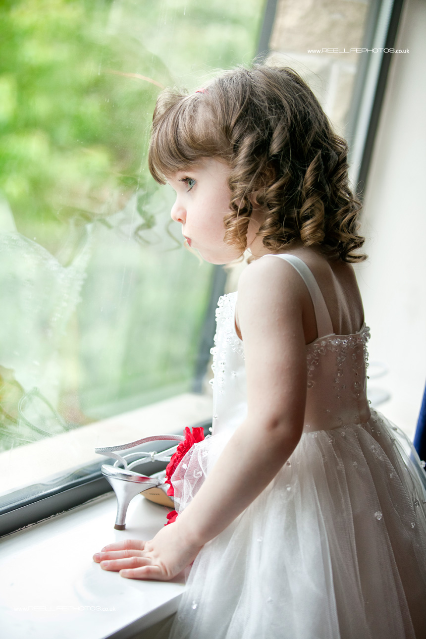 cute little bridesmaid by the window
