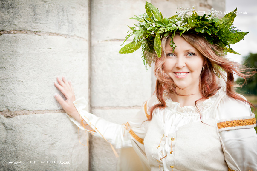 Beautiful bride with headress from leaves and tiny white flowers