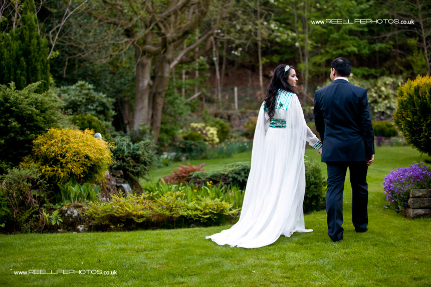 Asian bride and groom walking hand in hand