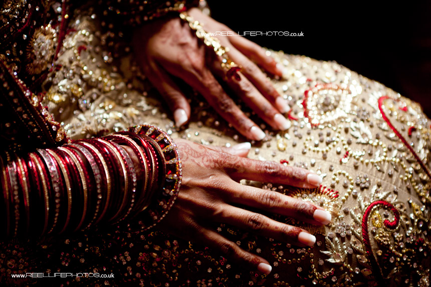Asian Bride's hand showing her Mehndi (henna) decorations