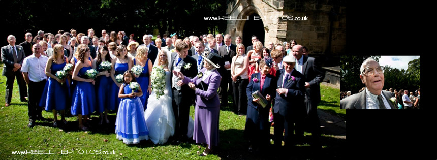 All the wedding guests in big group photo outside the church at Nostell Priory