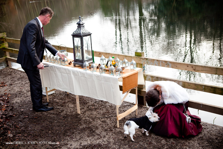 Lighting the candles at unusual wedding in the woods in Leeds