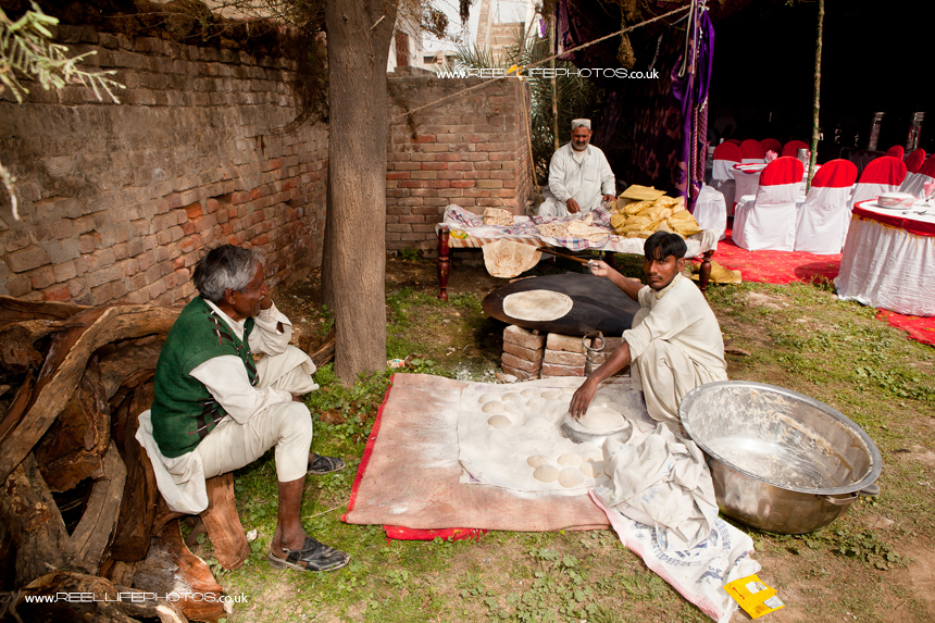 Asian wedding in Pakistan with chapati maker