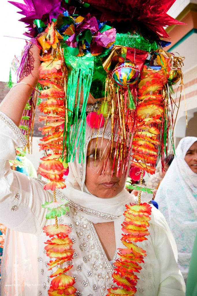 Pakistani Asian Groom's mother with traditional wedding headdress