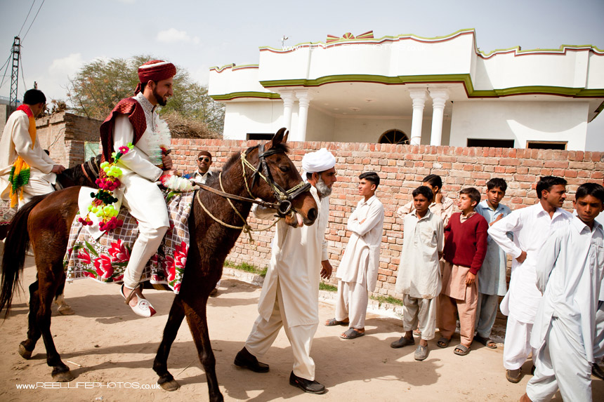 Groom on horseback at Asian wedding in Pakistan