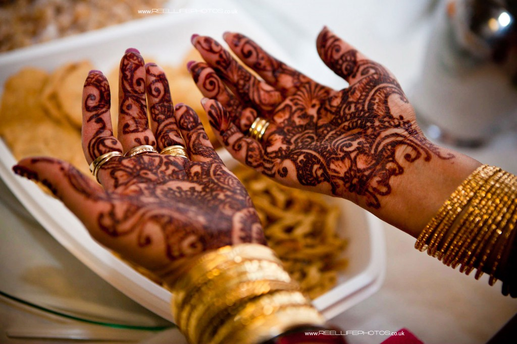 hands with henna at Hindu wedding Mayaan ceremony