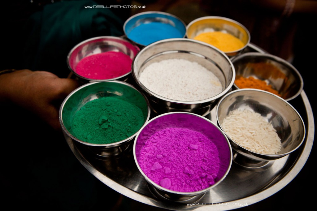 Hindu wedding photography of Mayan tradition with coloured powders