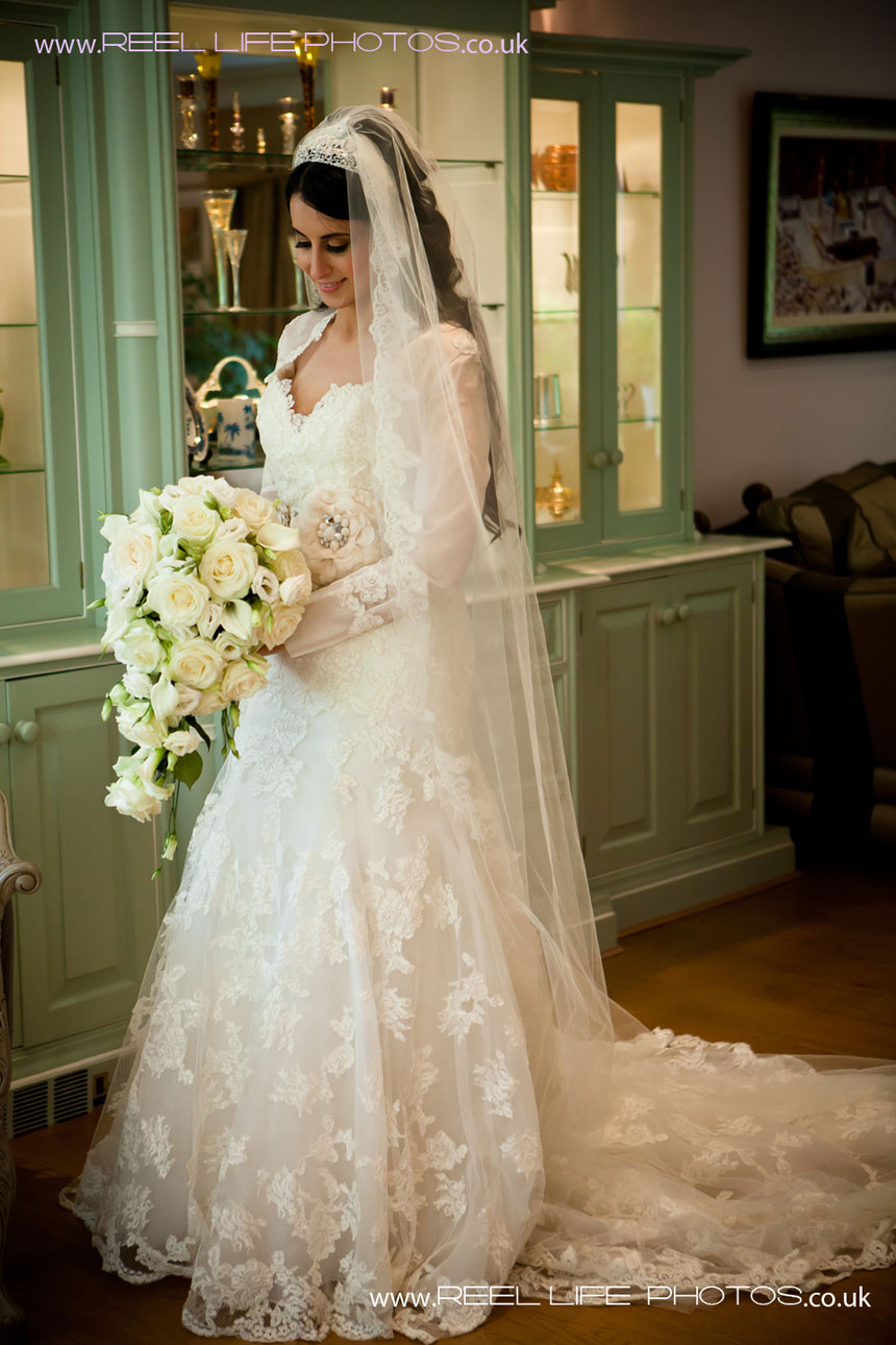 Arabic bride in her lacy white wedding dress - photography by Reel Life Photos