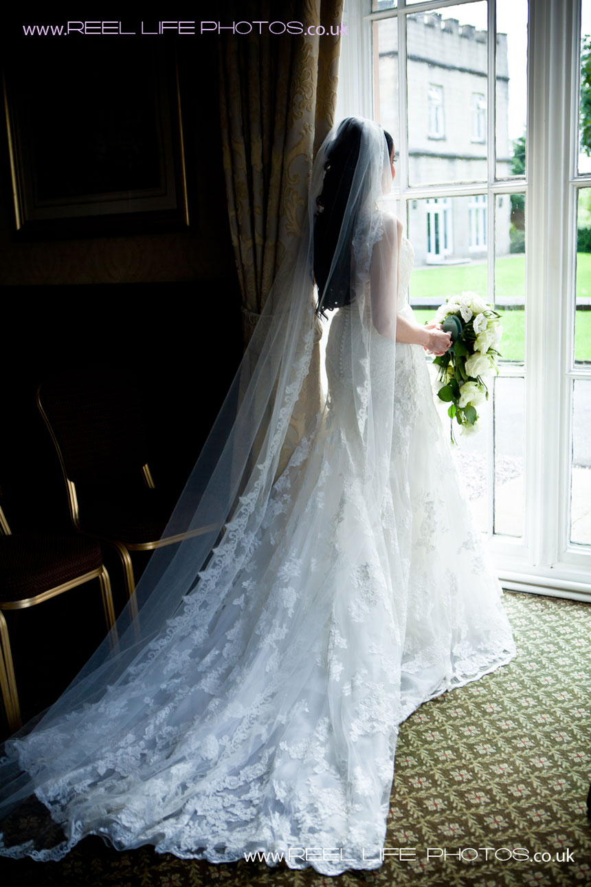 Bride by the window at Mercure Dunkenhalgh hotel, Blackburn Road, Clayton Le Moors, Lancashire, BB5 5JP
