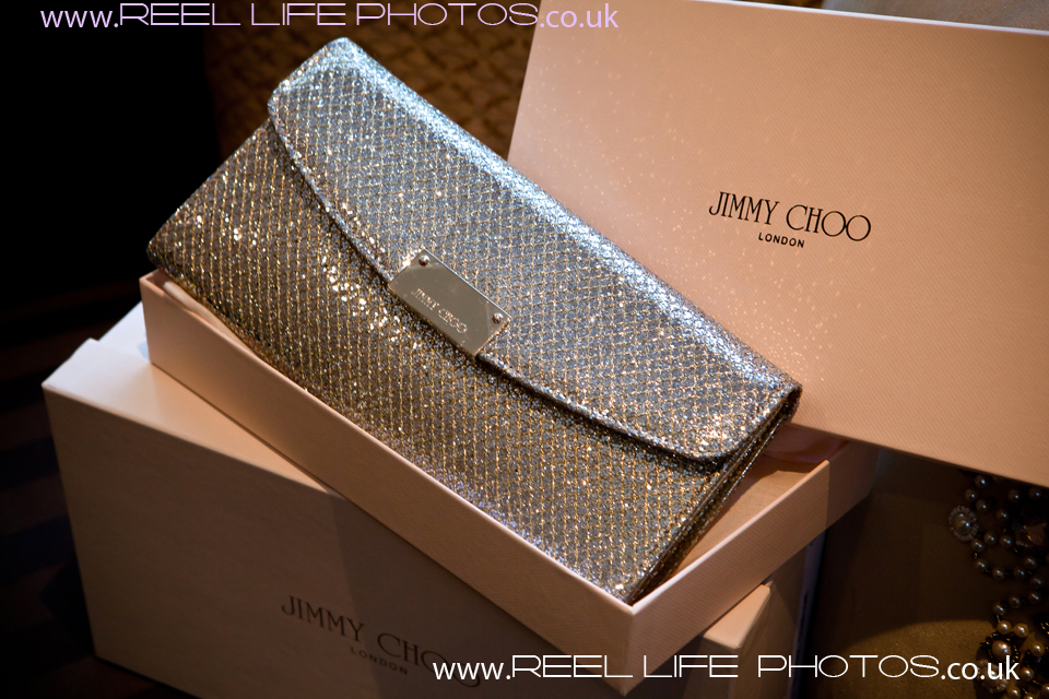 Jimmy Choos and designer handbag