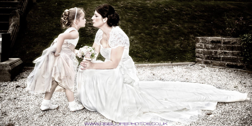 natural wedding photgraphy in Leeds with bride and flower girl