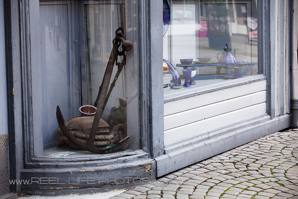 Tasteful antiques decorate this shop window in Sandnes, Norway.