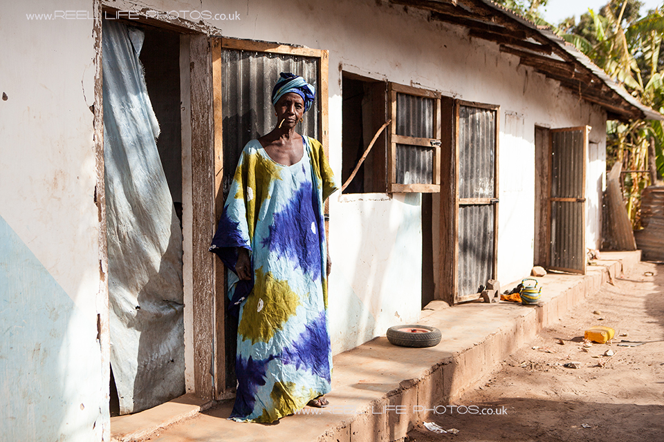 Beautiful Gambian lady by her house in the village of Jorem.