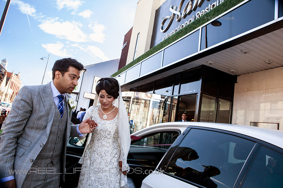 Professional Pakistani wedding photography outside Nawab's in Manchester