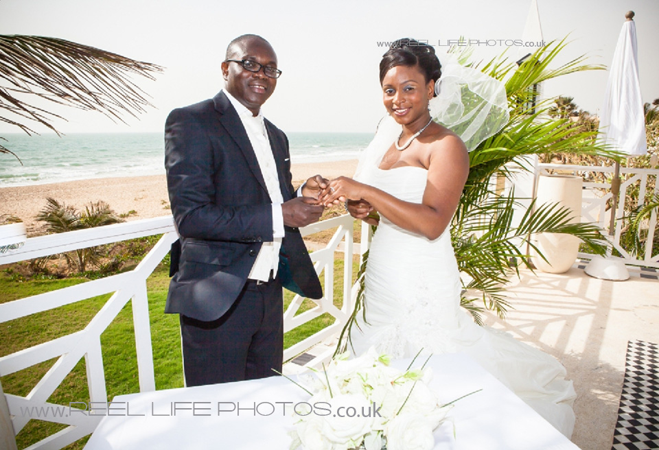 Coco Ocean romantic wedding picture by the sea of bride and groom and the rings