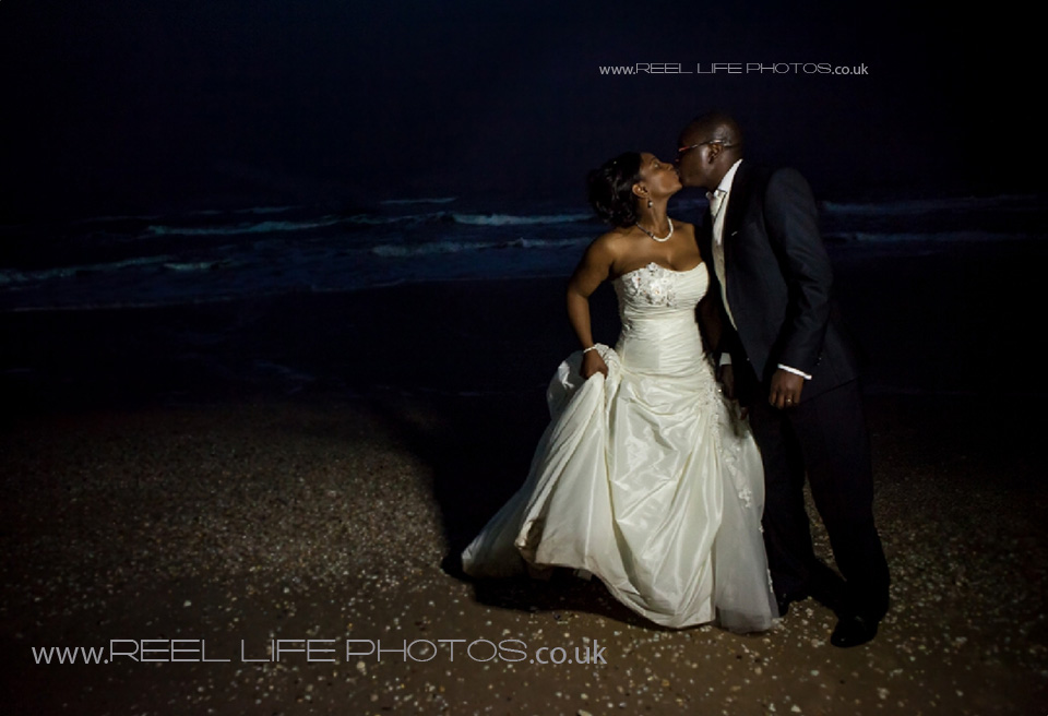 romantic wedding picture on the beach by the sea in Gambia at night