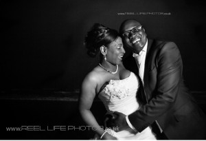 fun black and white wedding photography in the Gambia at Coco Ocean at night