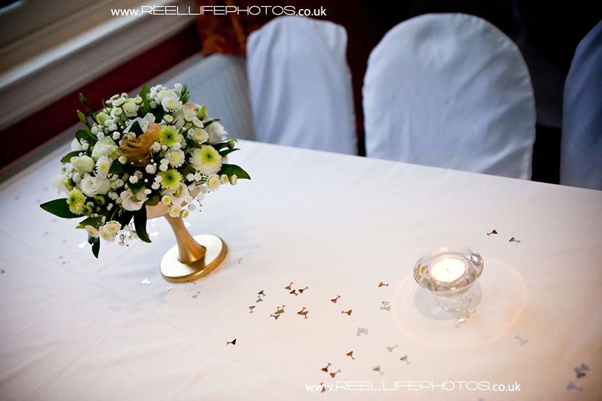 wedding table with flowers ready for evening wedding reception